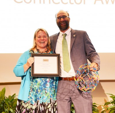 Matt Leslie Receives the Community Connector Award from Kelly King Horne, Executive Director of Homeward